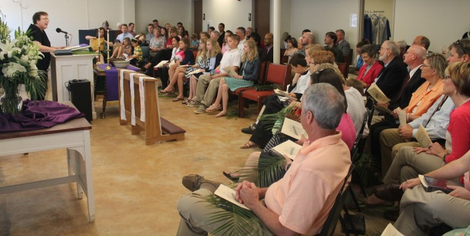 Pastor Lisa Caine preaches to a packed house at the April 13 worship service.